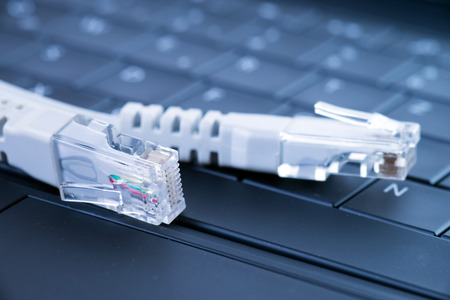 network cable: Computer keyboard with network cable Stock Photo