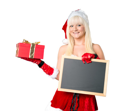 Woman with empty chalkboard and Christmas present photo