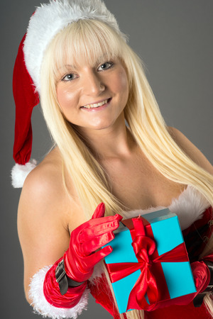 pretty woman with Christmas present photo