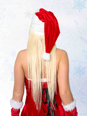Back of a beautiful woman in christmas costume photo