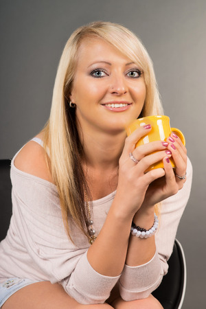 young woman with a cup photo