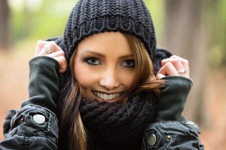 pretty woman in the autumn forest photo