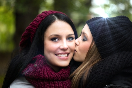 connectedness: two girlfriends in an autumn forest Stock Photo