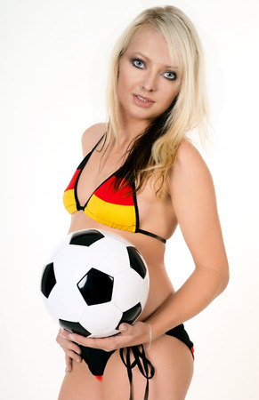 pretty woman with a soccer ball photo