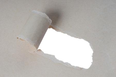 strikingly: torn open piece of paper