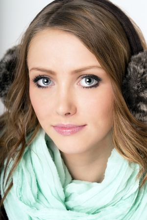 Earmuffs: young woman with earmuffs