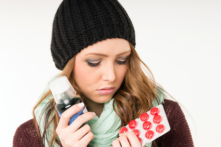 incapacitated: sick woman with tablets and medicines Stock Photo