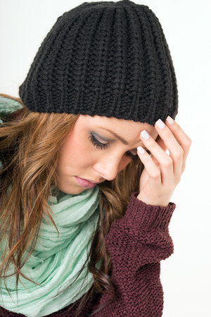 incapacitated: Woman with common cold and headaches