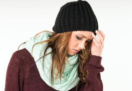Woman with common cold and headaches
