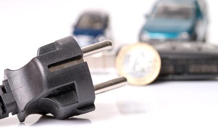 power of money: Power plug with euro money and car key Stock Photo
