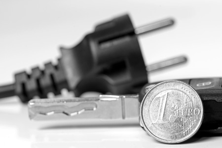 power of money: Power plug with euro money and car key in black and white Stock Photo