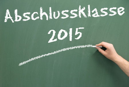 abi: Chalkboard with the german words graduating class 2015 Stock Photo