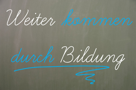 retraining: Chalkboard with the german words Next come through education