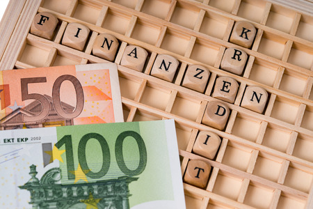 editions: Wooden cubes with the german words Finance and Credit Stock Photo