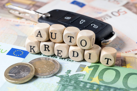 editions: Euro Money and wood cubes with the german words car loan