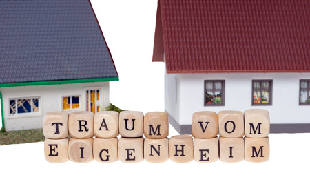 home ownership: Wooden cubes and the german words dream of home ownership