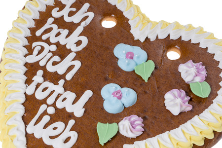 snacking: Gingerbread heart with the german words I got you totally sweet Stock Photo