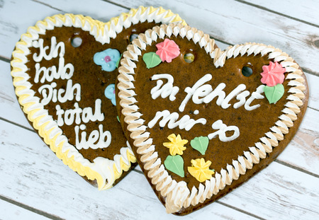 two gingerbread hearts over a wooden background photo