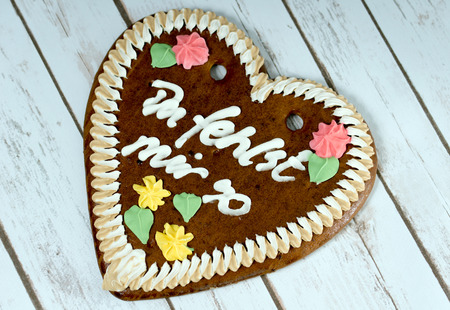 i miss you: gingerbread heart with the german words I miss you so