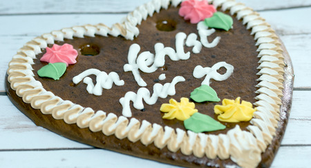 love proof: gingerbread heart with the german words I miss you so