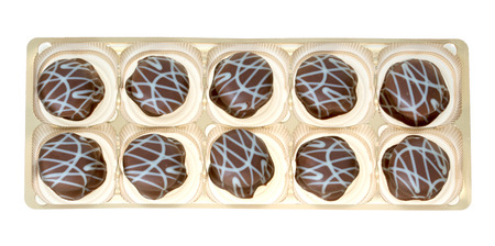 exempted: delicious pralines in a box isolated over a white background