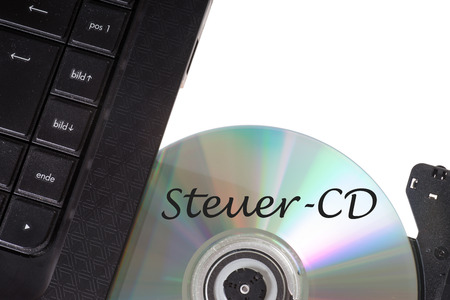 treaties: Computer with Tax evaders CD Stock Photo