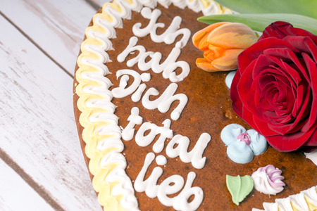 love proof: Gingerbread heart with the german words I love you totally sweet