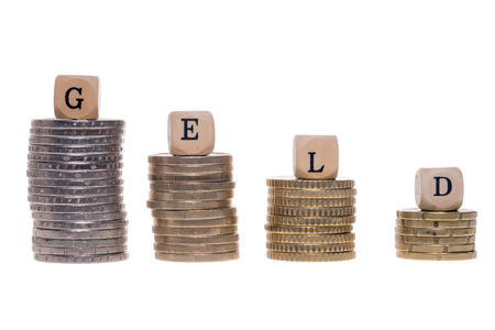 money stack: Money stack and wood dice with the german word money Stock Photo
