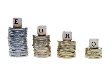 money stack: Money stack and wood dice with the word Euro Stock Photo