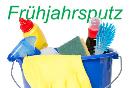 spring cleaning: Cleaner with brush in a bucket and the german word Spring cleaning Stock Photo