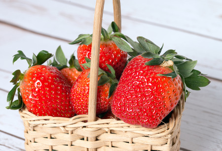 biologically: Strawberries in a small basket Stock Photo