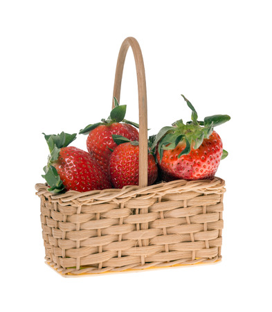 exempted: Strawberries in a small basket isolated over a white background Stock Photo