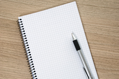 Blank writing pad with a pen