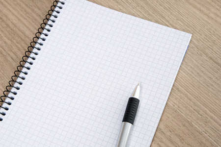 space to write: Blank writing pad with a pen