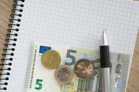 bank records: Blank writing pad with a pen and euro money