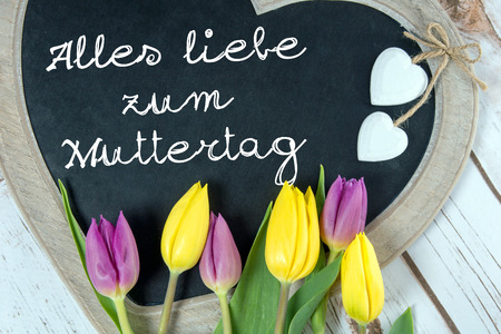 all love: Wooden panel in heart shape with the german words all love for Mothers Day Stock Photo