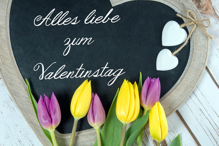 all love: Wooden panel in heart shape with the german words all love for Valentines Day