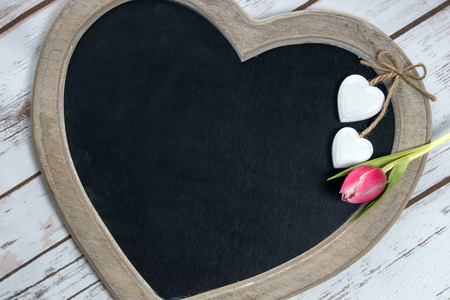 Wooden panel in heart shape with tulip