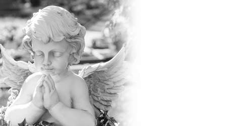 bereavement: Angel on a cemetery in black and white