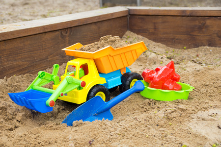 sand toys: Sand toys in a sandbox Stock Photo