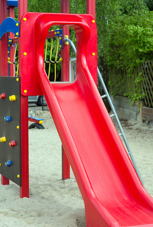 recreational climbing: Climbing scaffold with slide in a playground Stock Photo
