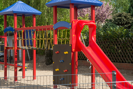 playground equipment: Climbing scaffold with slide in a playground Stock Photo
