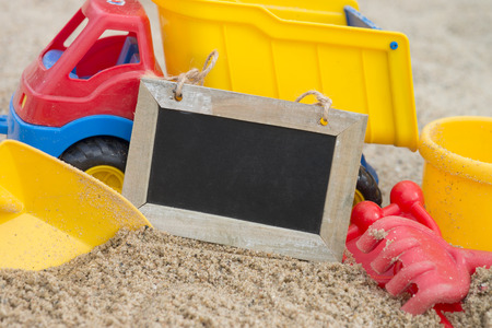 sandbox: Sand toys in a sandbox with empty plate Stock Photo
