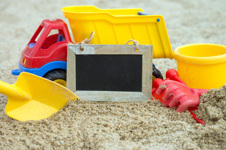 sand toys: Sand toys in a sandbox with empty plate Stock Photo