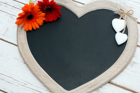 cordial: Wooden panel in heart shape with Gerberas