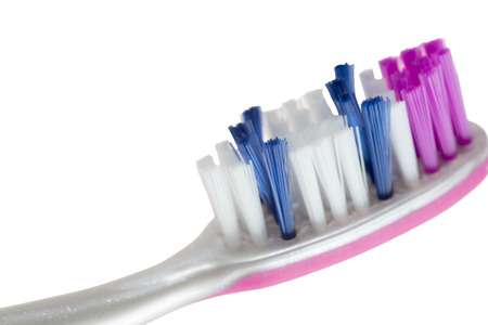 periodontal disease: Toothbrush on white background