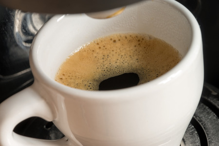 caffeinated: a cup of espresso is brewed