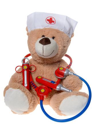 exempted: Teddy with stethoscope and syringe isolated on white background