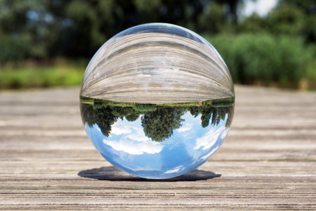 reflect: Glass sphere picture in nature with blue sky Stock Photo