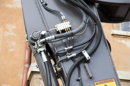 hoses: Hydraulic hoses to a construction equipment